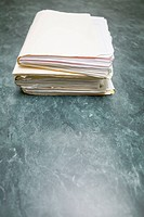 Files stacked on conference table, concept photography