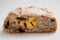 Close up of whole wheat bread with raisin, cheese.