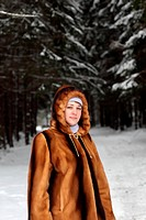 The woman poses in winter park, Russia