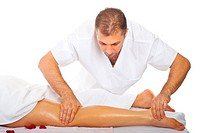 Real proffesional masseur massaging woman´s leg with oil