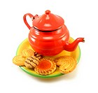 image of a red teapot with some biscuits and tarts