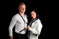 young couple stretching suspenders