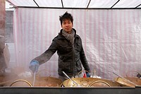 Portrait of a young Asian man cooking at street food stall