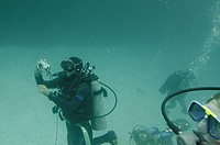 Scuba divers underwater photographing, San Cristobal Island, Galapagos Islands, Ecuador