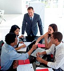Business people shaking hands in a meeting. Agreement in business
