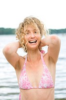 Photo Of A Blond Curly Woman Having A Good Time Near Water