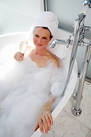 Mature woman enjoying bubble bath (thumbnail)