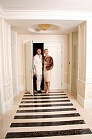 Mature couple entering a hotel suite