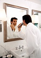 Man shaving in the bathroom mirror (thumbnail)