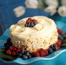 Cake with Vanilla Cream Icing, Toasted Coconut, Raspberries and Blueberries