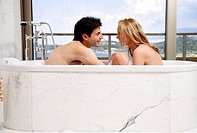 Couple enjoying bubble bath together