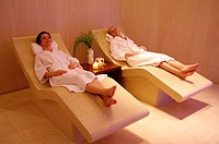 Two young women relaxing at a spa together