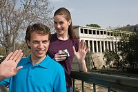 Couple at archaeological site waving