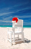 Santa´s hat and chair on the beach