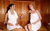 Two young women enjoying a sauna