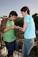 Man reading woman´s palm at archaeological site