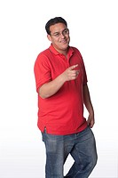 Studio portrait of young confident Hispanic man on white background talking and looking happy