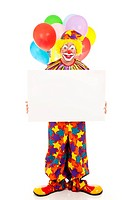Happy clown holding a blank sign. Full body on white.