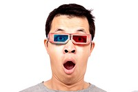 Young man with 3D glasses on watching a 3D movie