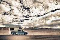 Truck camper in desert, Death Valley National Park, Death Valley, California, USA