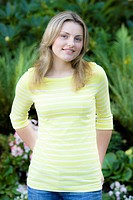 Portrait of a Pretty Blond Teen Girl Standing With Hands In Pockets