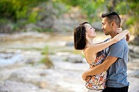 Young couple in love - man, 22, hispanic, woman, 20, korean, location natural environment near Leakey, Texas, USA