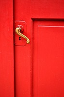 red door with curved brass handle - shot straight on