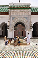 Muslim men cleaning their feet before prayer in the courtyard of Kairouan mosque and university, Medina, Fes, Morocco, Africa
