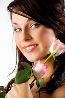young cute brunette with pink roses and wearing a pink dress