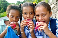 Schoolgirls eating ice cream, Mahe, Seychelles, Africa