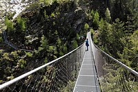 Suspension bridge across the Riesachfall waterfall, Alpinsteig Hoell hiking trail, Naturpark Soelktaeler nature park, Schladminger Tauern mountain ran...