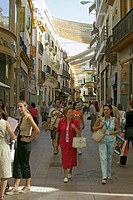 Women shop in old section of city of Sevilla, Andalucia, Southern Spain
