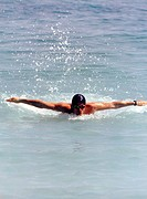 Man Swimming The Breast Stroke.