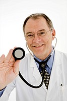 Male doctor holding stethoscope, close_up, portrait