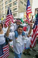 Father with daughter on his shoulders protests with hundreds of thousands of immigrants in march for Immigrants and Mexicans against Illegal Immigrati...