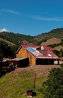 Old barn painted with ´God Bless You´ in Yreka, California