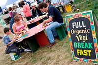 People eating at an outdoor organic vegetarian cafe at the WOMAD World of Music, Arts and Dance Festival in reading, 2005,