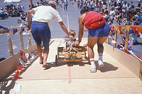 Parents with child in Soap Box Derby