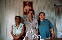 Family group with woman standing with her father and mother in farmhouse near Vinales, Pinar Province, Cuba,