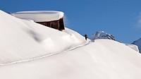 Female backcountry skier and a alpine cabin, Tux Alps, northern Tyrol, Tyrol, Austria, Europe