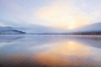 Foggy sunrise over Beaver Lake in the Stillwater State Forest near Whitefish, Montana, USA