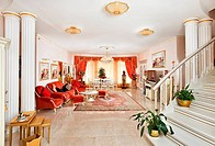 Classic style drawing_room interior in red and golden colors, view from hall