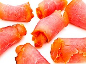 Close up photo of the red tasty smoked rolled meat against the white background