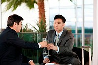 Businessmen toasting with wine