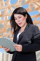Asian woman contractor with a set clipboard