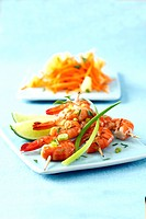 Gambas brochettes with lime and spring onions