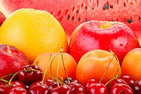 Composition with variety of fresh fruits with visible drops of water
