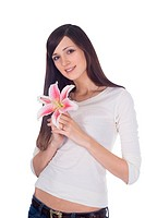 Brightly portrait of young lovely brunette with flower in hands