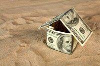 Dollar house on sand. Real estate concept