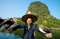Cormorant fisherman, Yangshuo, Li River, Guangxi, China.